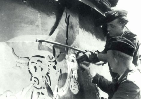 A snorting bull being applied by stencil to U-567