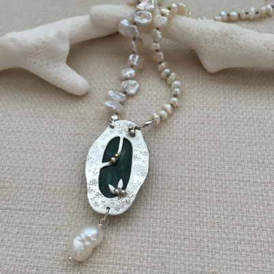 metalsmith emerald necklace
